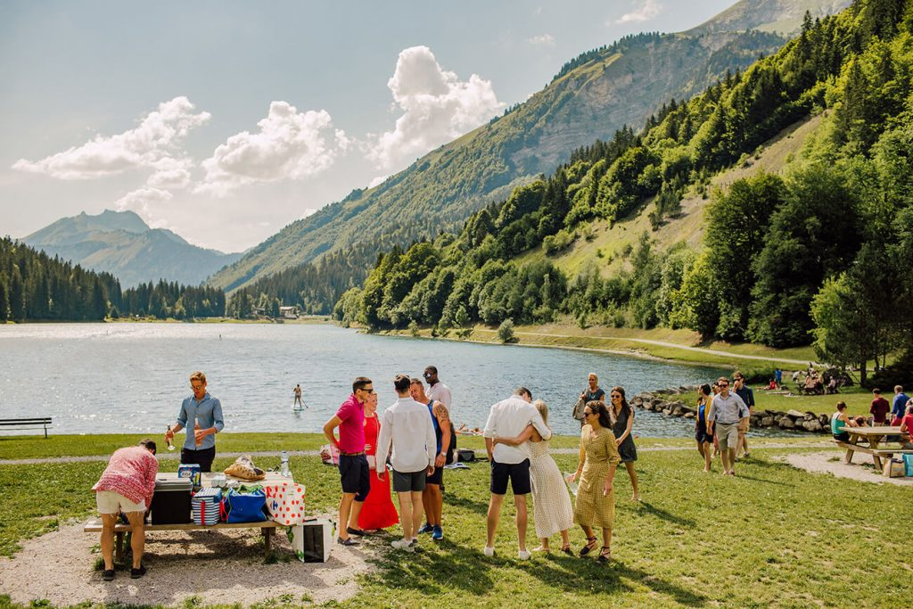 friends having bbq and swimming in lake montriond at the french alps