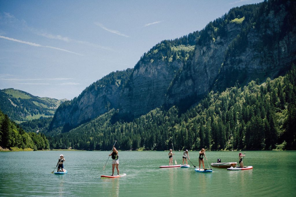 ladies paddle board at Lake Montriond in Morzine
