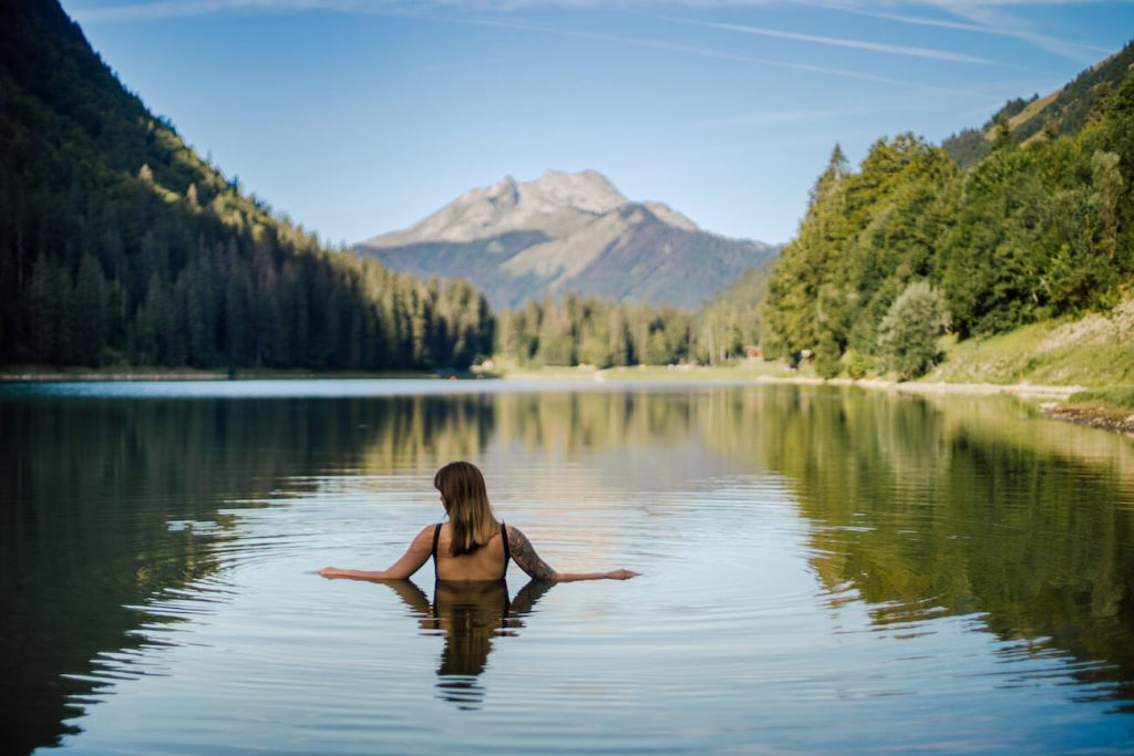 lady swimming at lake montriond in the french alps