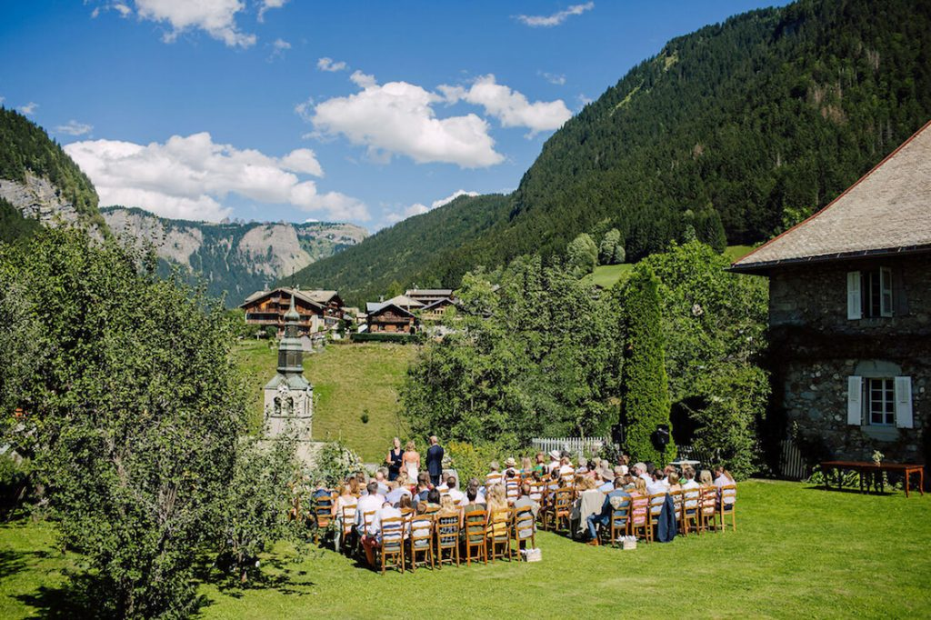 wedding ceremony on the lawn of the farmhouse hotel in morzine