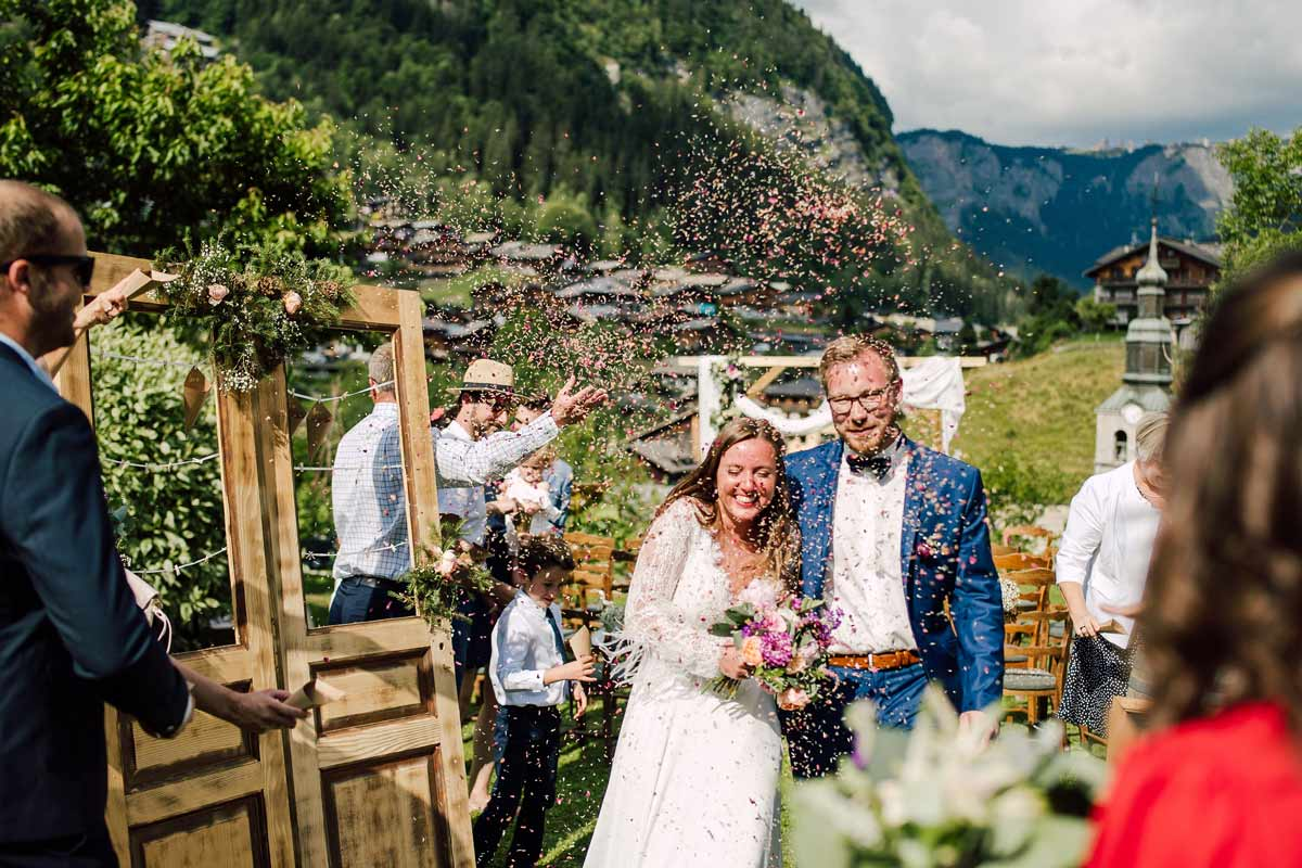 bride and groom exit toss at the french alps