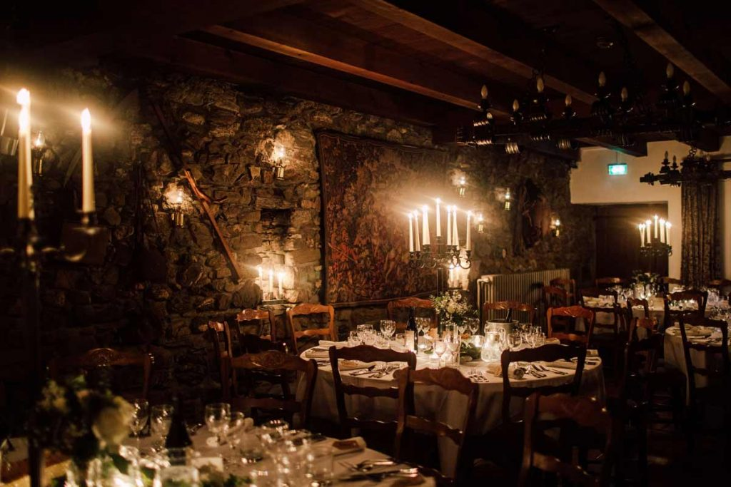 candle lit wedding dining room at the Farmhouse hotel in Morzine