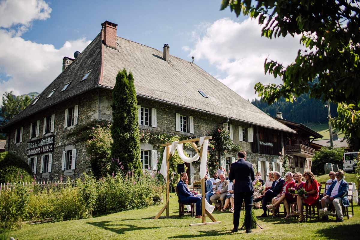 wedding ceremony in farmhouse venue at the french alps
