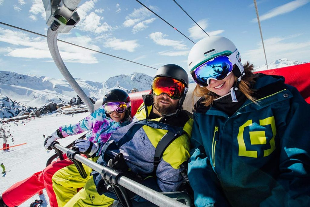 skiers selfie on a chairlift in avoriaz at the portes du soleil