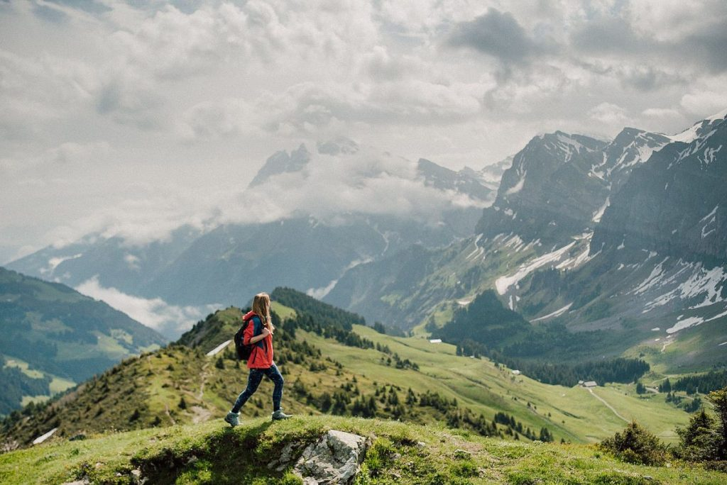 woman enjoys the view doing one of the easy hikes around morzine