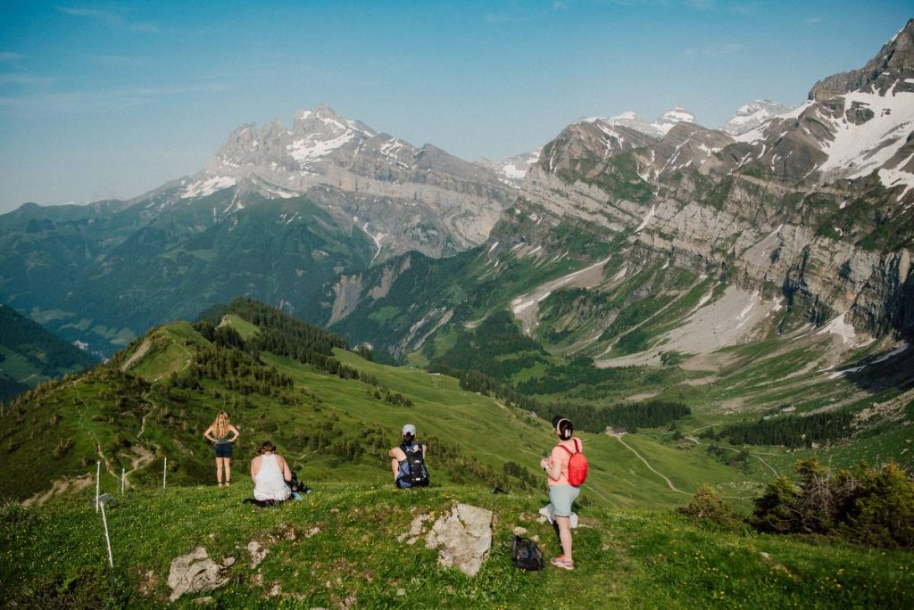 group enjoy the view from Col de Cou during one of the easy hikes around morzine