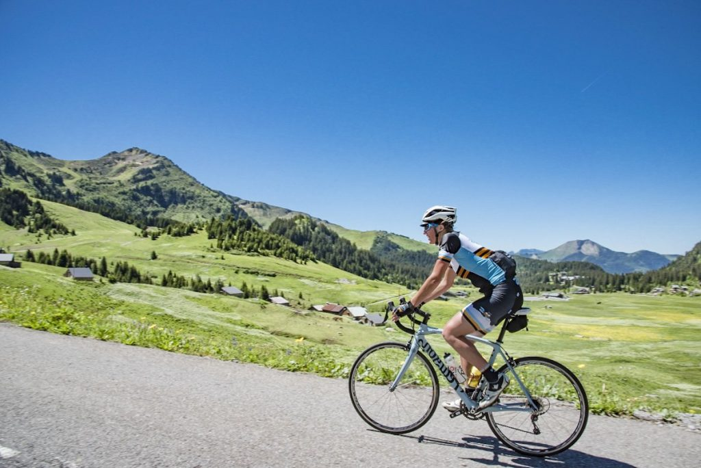 Cyclist climbs Col de la Ramaz, one of the most famous road cycling routes around Morzine