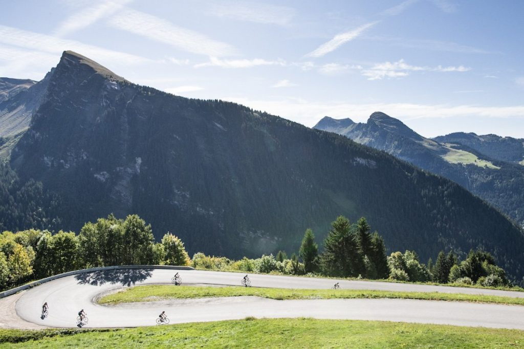 cyclists descend the Route de Avoriaz, one of the most famous road cycling routes around Morzine