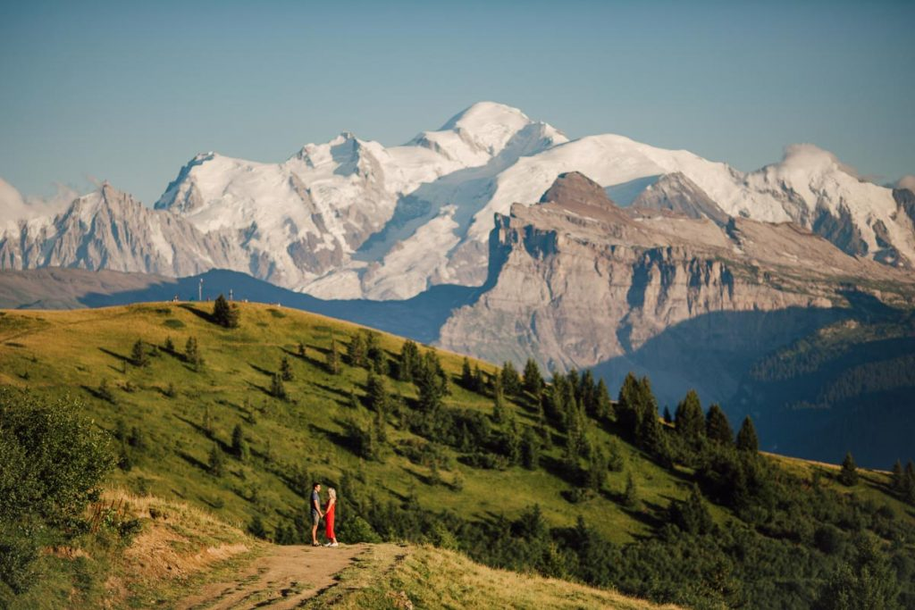 couple embrace whilst doing an easy hike around morzine