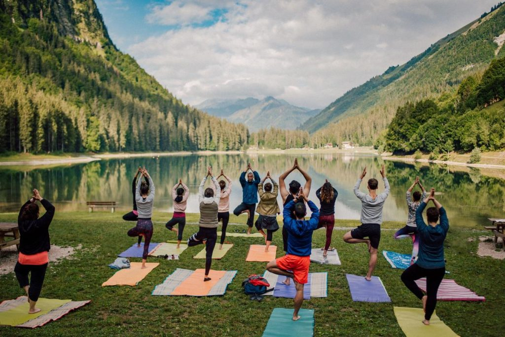 group yoga class at lake montriond in morzine
