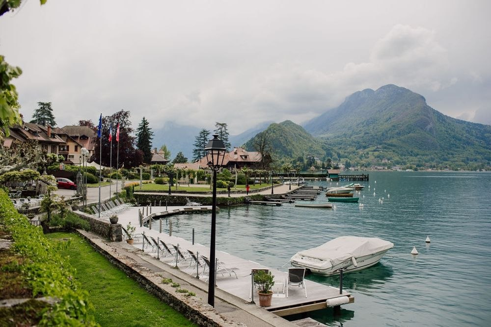 Talloires is a lovely quiet lakeside town near Morzine with small boats afloat by the jetty