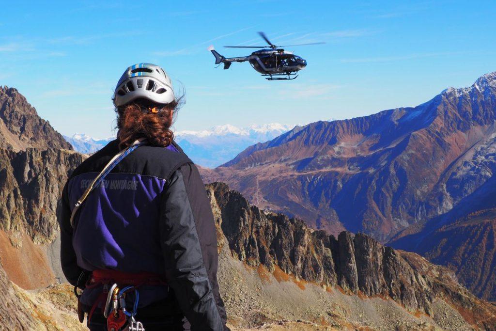 secours en montagne team member asses the slopes during the summer