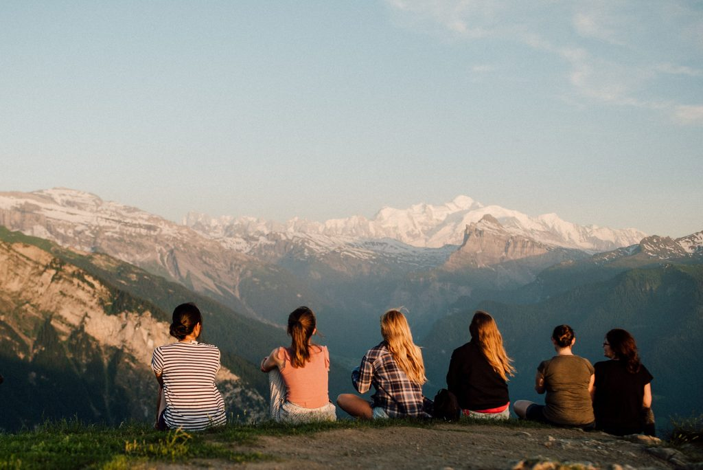 group of people watching sunset at la bourgeoise looking at the mont blanc