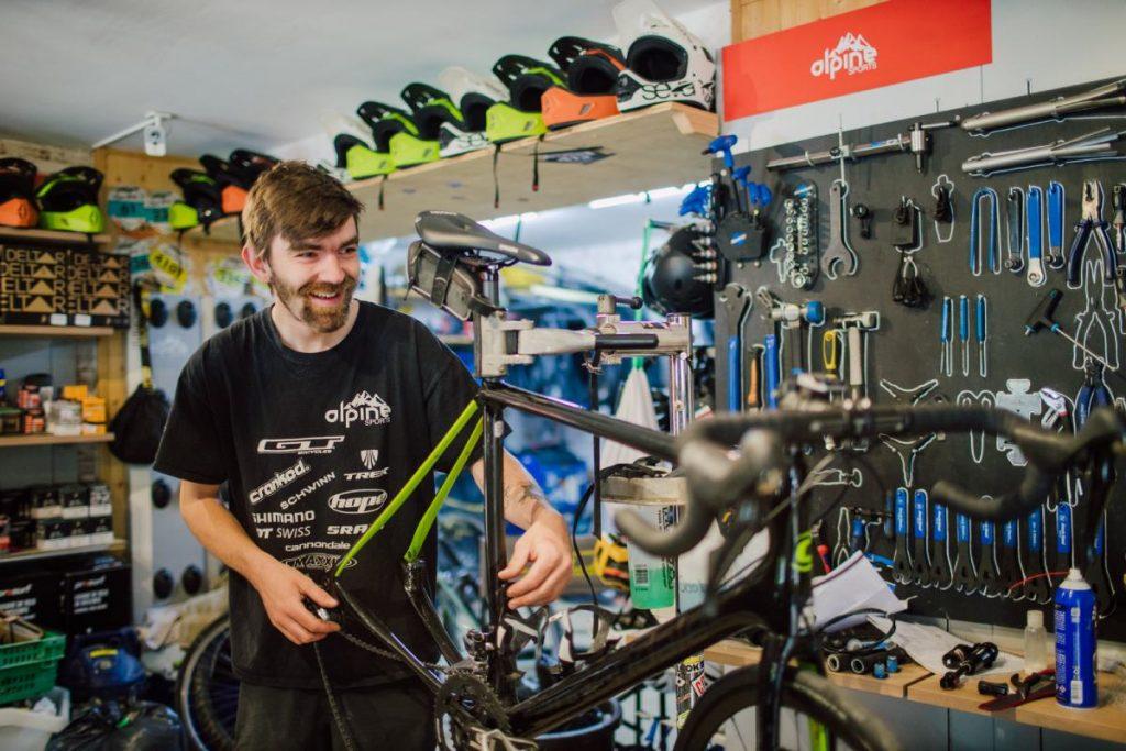Mechanic at Alpine Sports road bike hire shop in Morzine