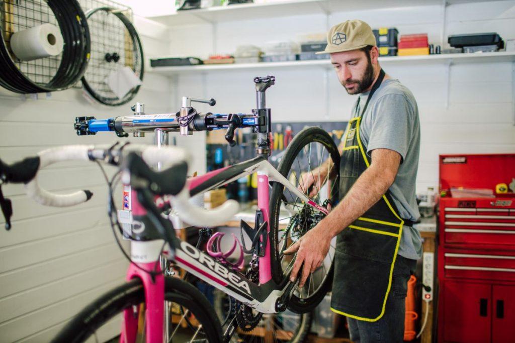 Mechanic at Torico hire bike shop in Morzine fixes a bike