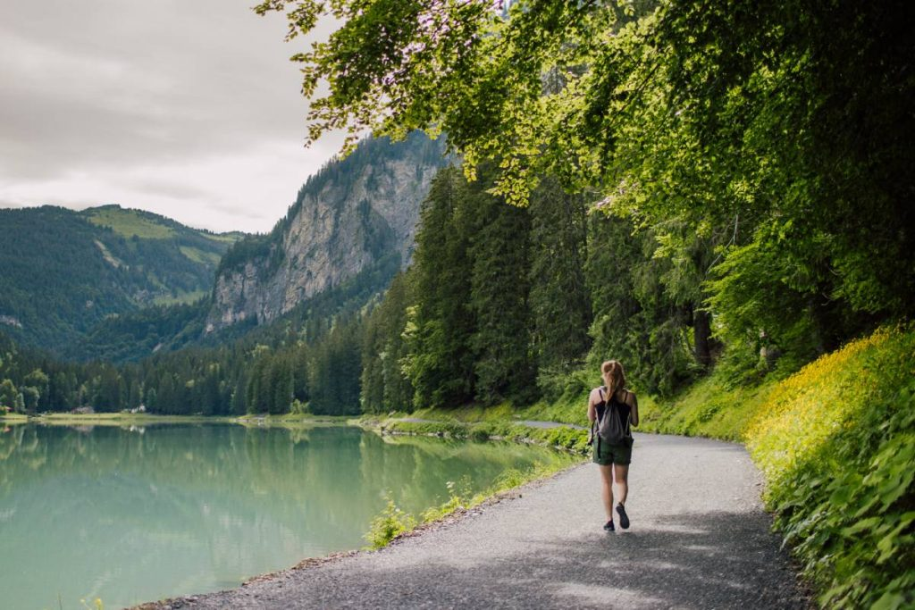 lady walking around lake montriond
