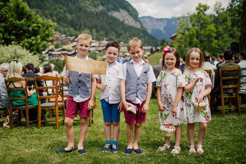 children wait for the bride and groom at wedding venue in Morzine