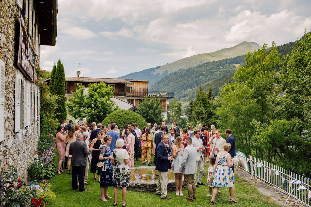 Guests mingle during wedding at The Farmhouse in the French Alps