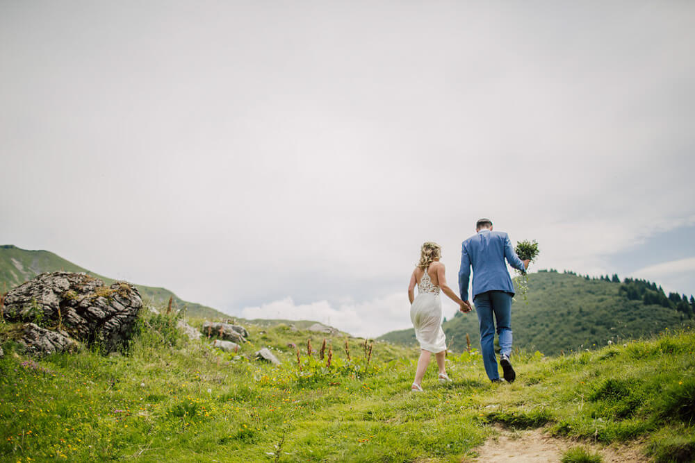Newly weds walk in the French Alps