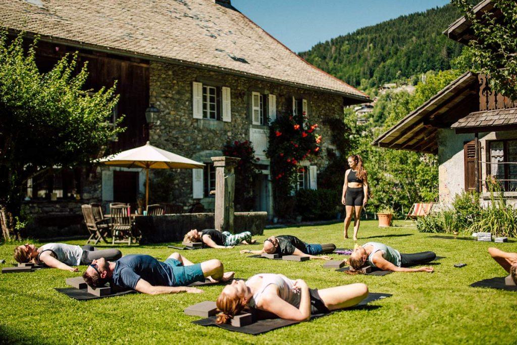 yoga class in the garden of the farmhouse morzine
