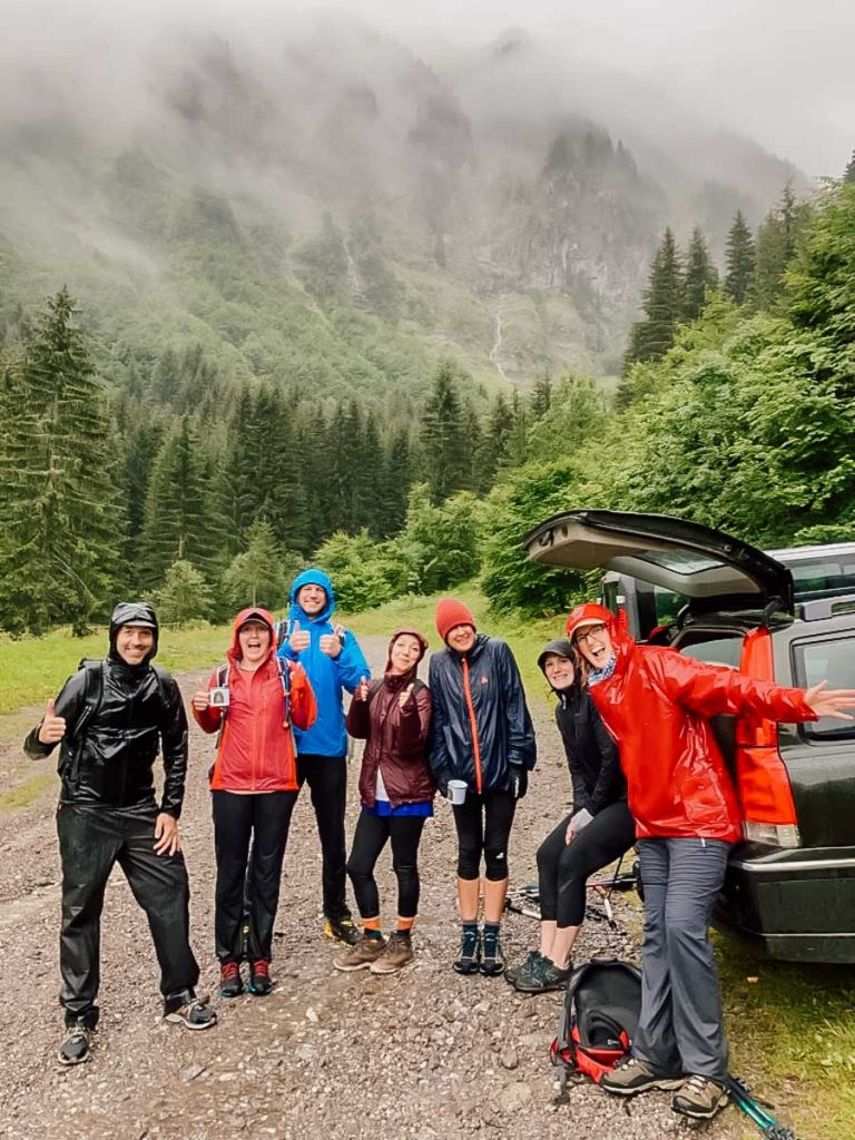 a group of hikers in the rain at the french alps