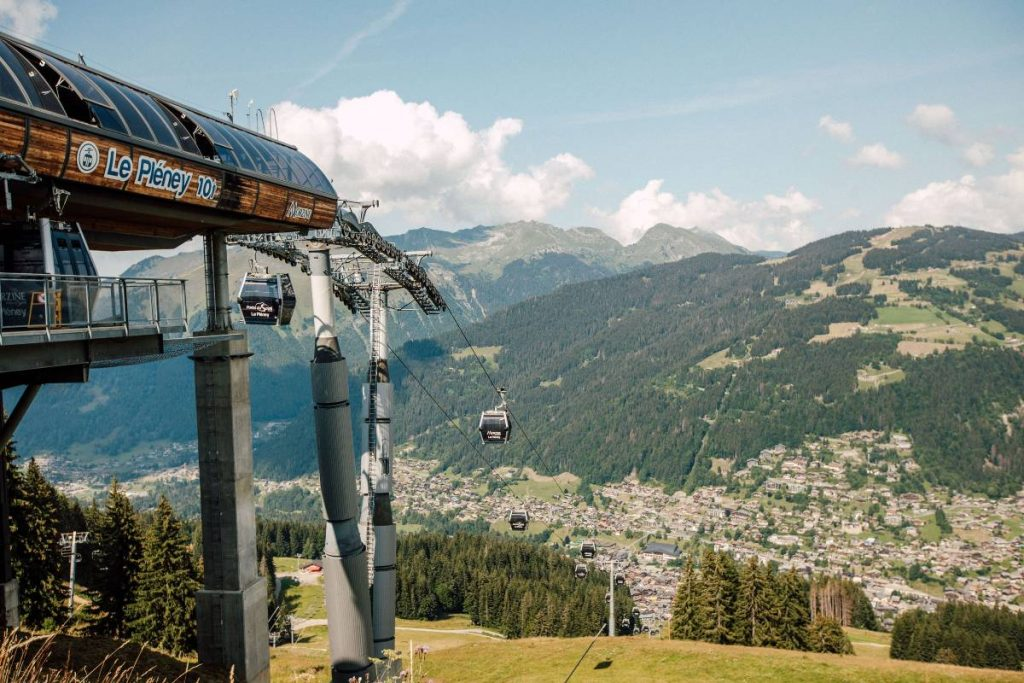 view of the telecabine Pleney in Morzine from the top and mountains